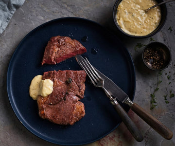 Sous vide rare beef steak with béarnaise sauce