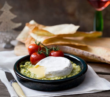 Melted Brie with basil and lemon pesto