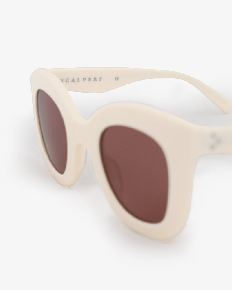 SUNGLASSES WITH WHITE RESIN FRAMES