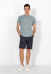 BERMUDA SHORTS WITH ALL-OVER SKULL PRINT
