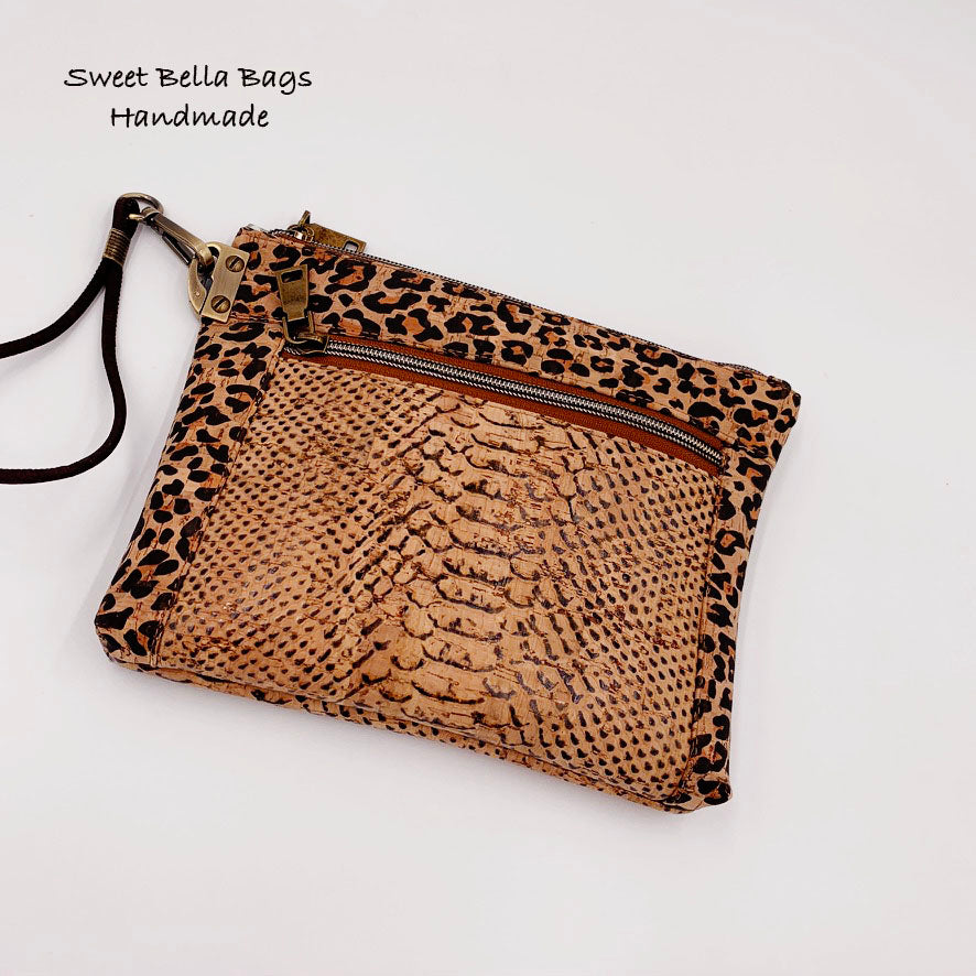 The Lexie Clutch in Snake And Cheetah Cork