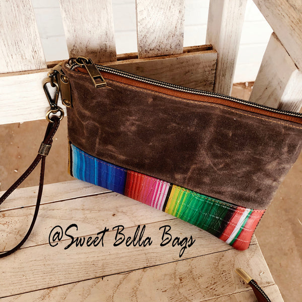 The Tiffany Clutch Bag Made From Serape Leather And Wax Canvas