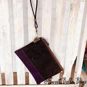 The Tiffany Clutch Bag Made From Chocolate Waxed Canvas And A Purple Cork Accent