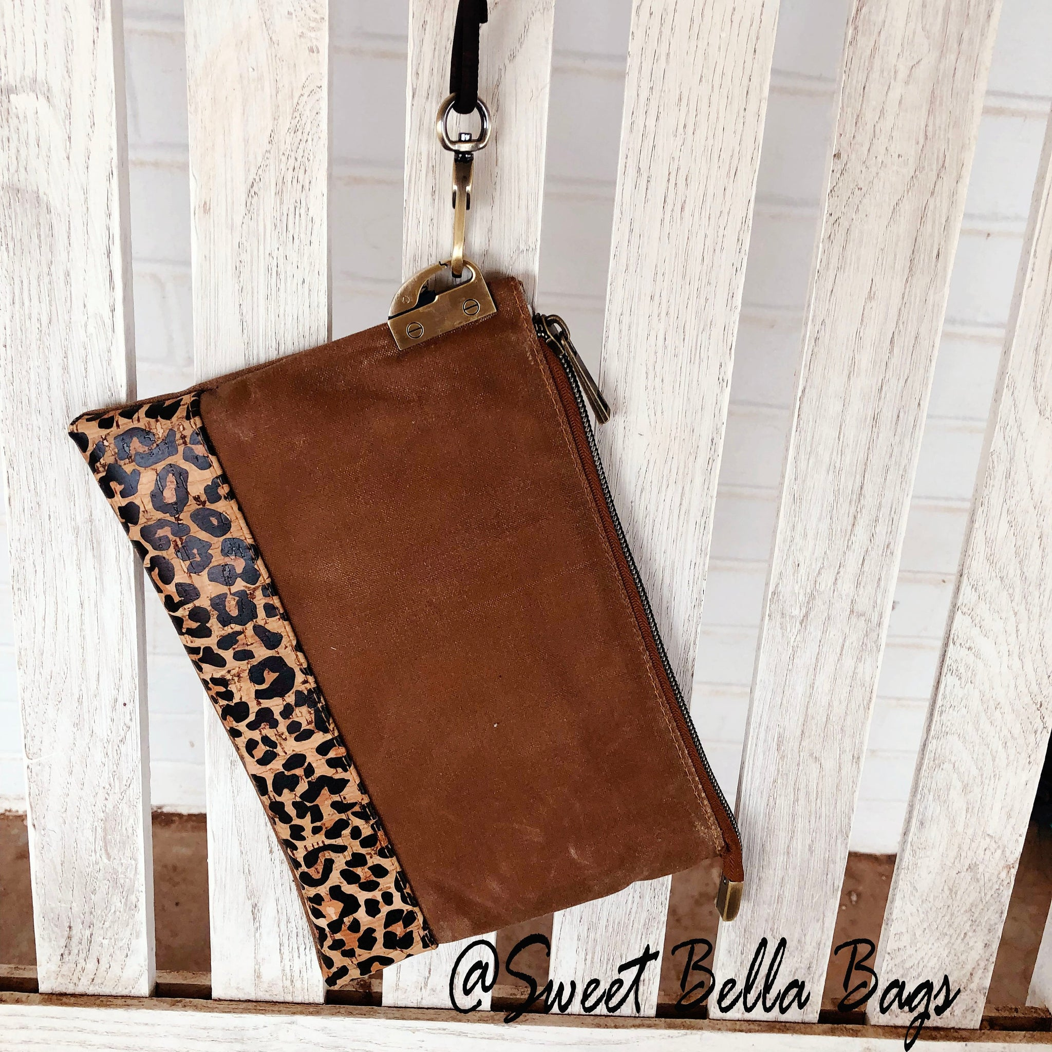 The Tiffany Clutch Bag Made From Tan Waxed Canvas And Cheetah Cork
