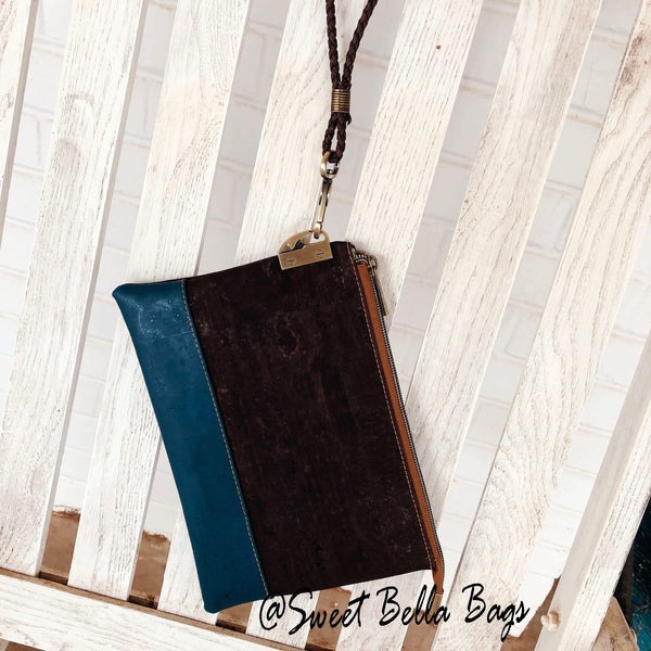 The Tiffany Clutch Bag Made From Chocolate Waxed Canvas and Teal Cork