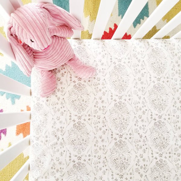 Crib Sheet in a Grey Gender-Neutral Floral Pattern