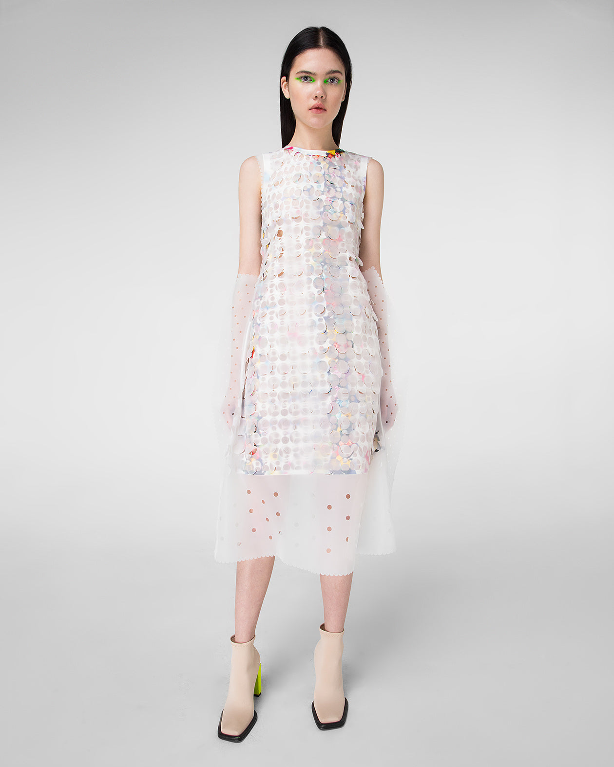 Sleeveless laser-cut dress with decorative belt