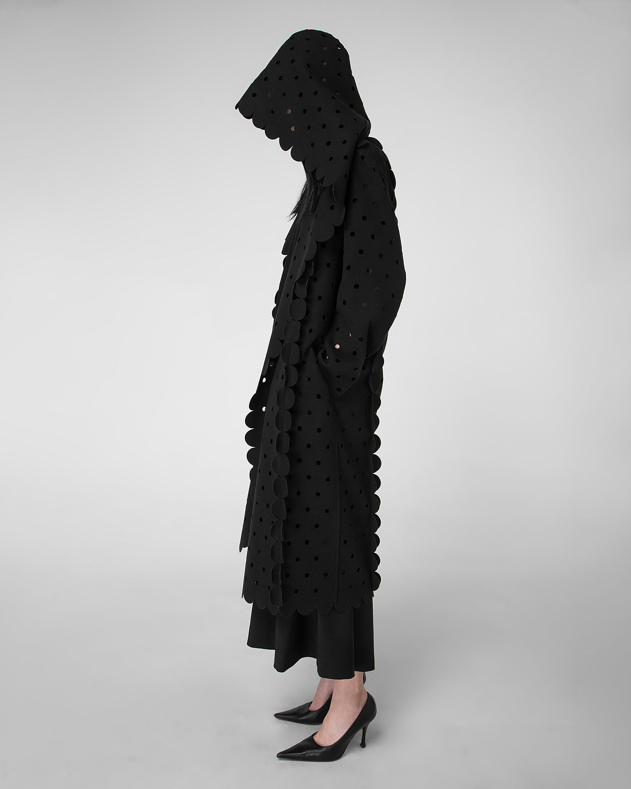 Hooded laser-cut coat with scalloped details