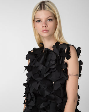 "Laser-cut appliqued ""butterfly"" top"