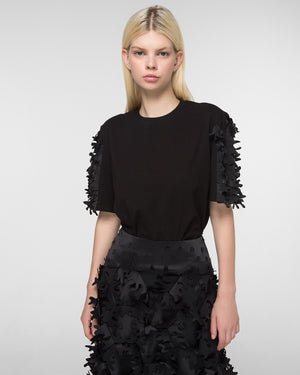 Appliqued skirt with laser-cut hem