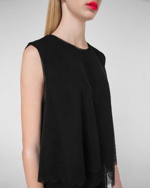 Sleeveless top with scalloped hem