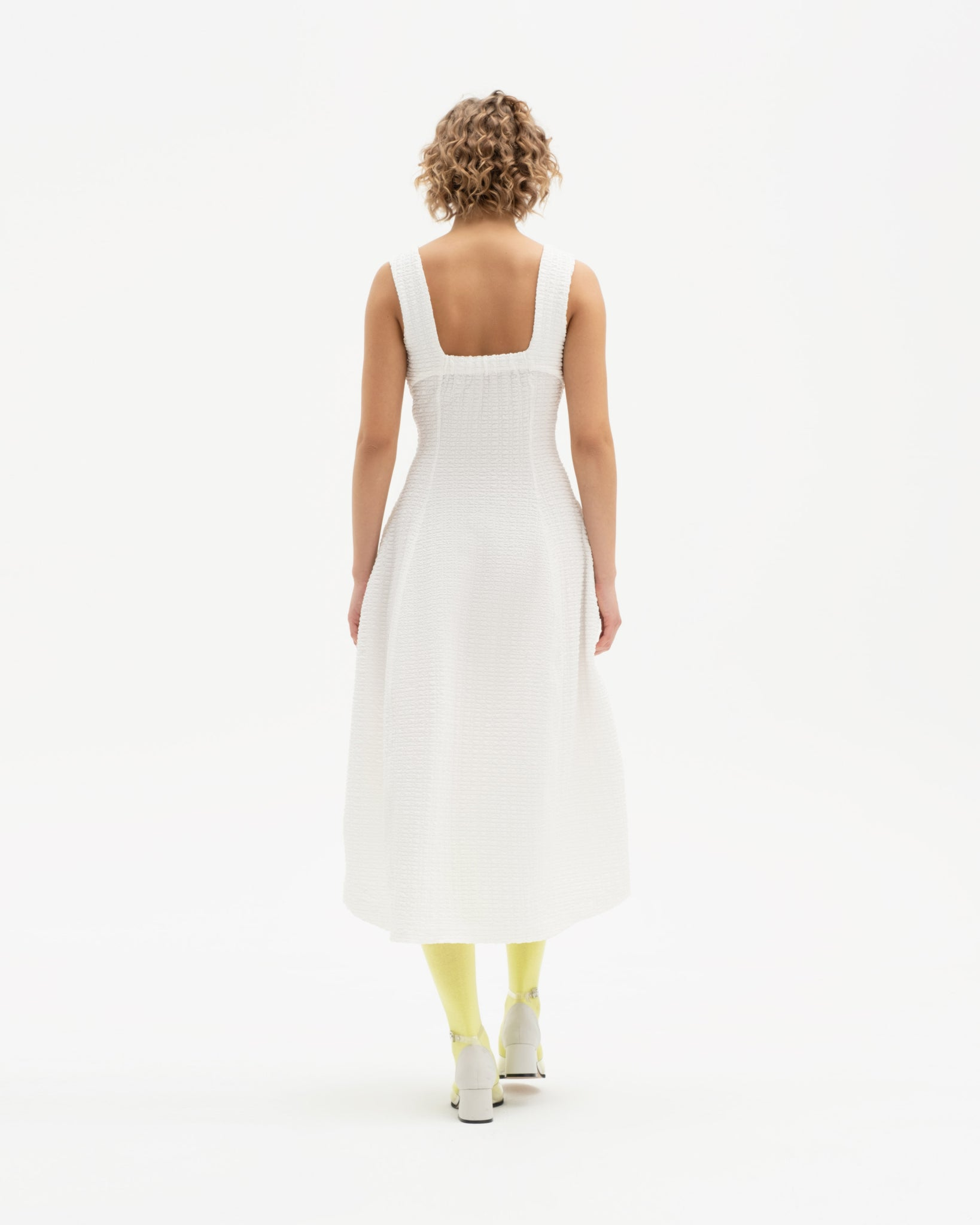 Square neck dress with assymetrical hem