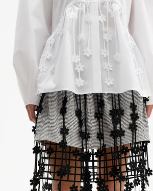 Flared mini-skirt decorated with laser-cut floral straps