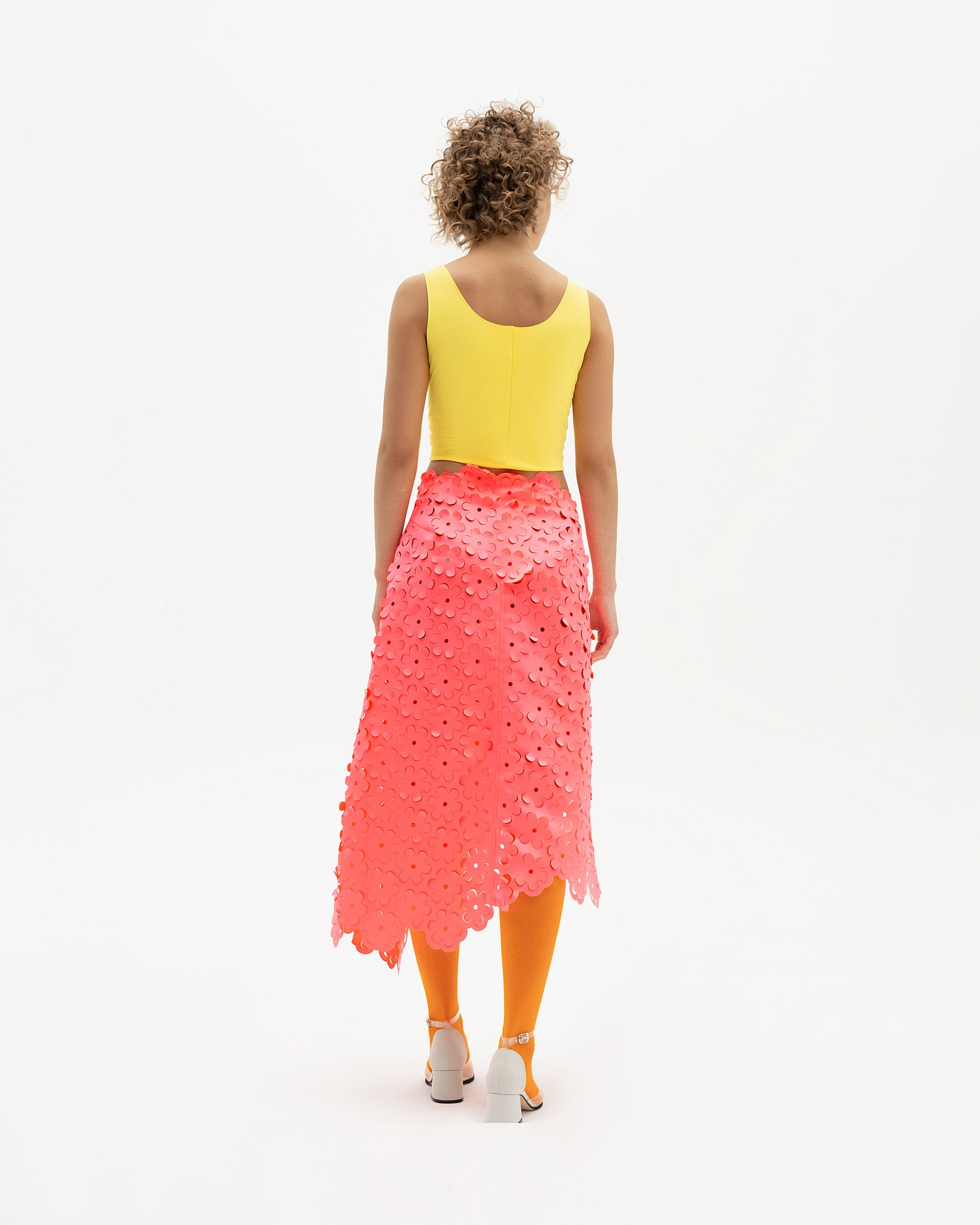 Laser-cut skirt with asymmetrical hem