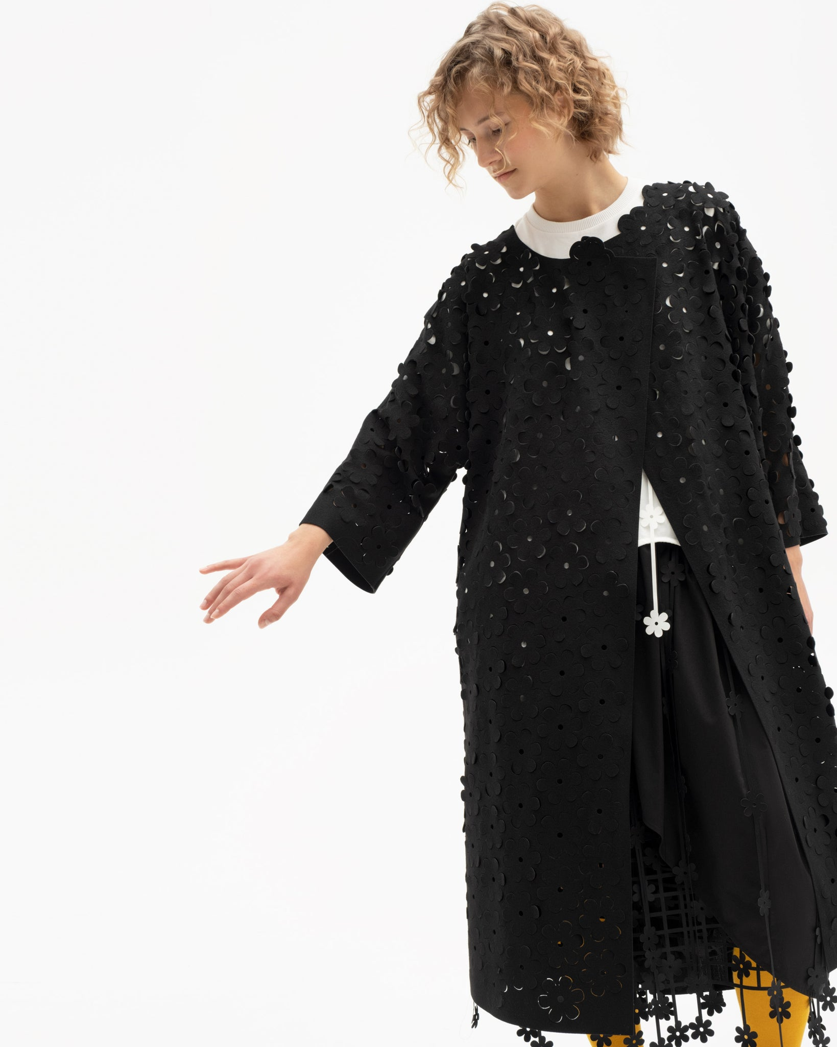 One-piece sleeve laser-cut coat