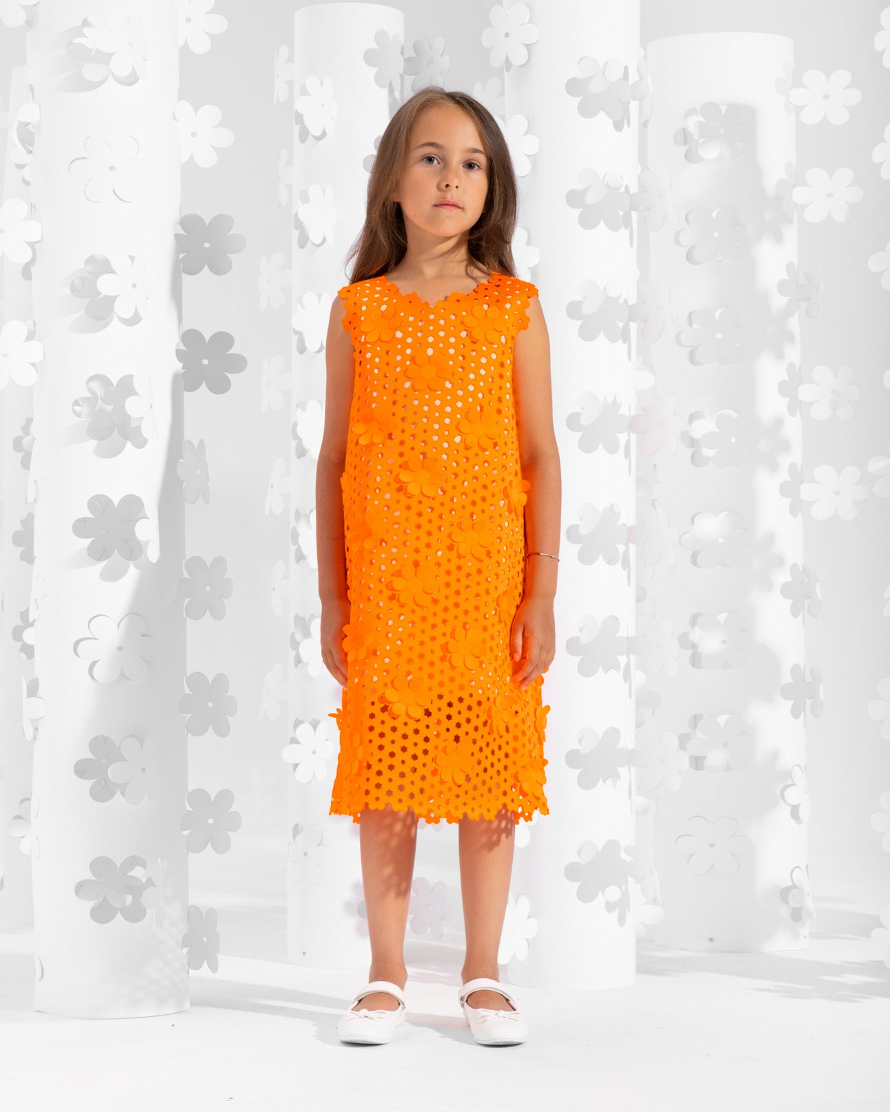 Sleeveless laser-cut dress trimmed with floral appliques