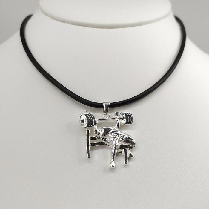 Worldwide shipping, bench press solid sterling silver pendant, exclusive handcrafted and well detailed image of a bodybuilder, available with leather cord or sterling silver chain.