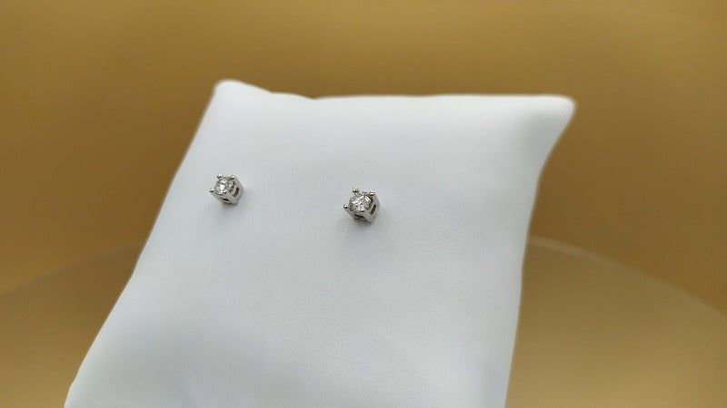 Pendientes solitario diamante talla brillante  0,26 cts
