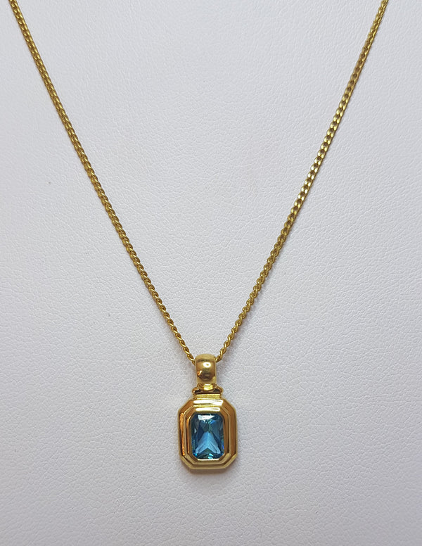 Emerald Cut Blue Topaz 9ct Yellow Gold Pendant