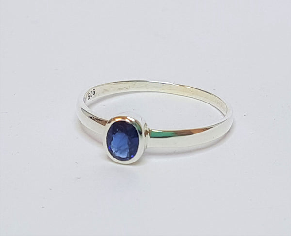 Oval Sapphire Bezel Set Sterling Silver Ring
