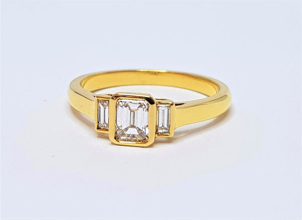 18ct Yellow Gold Emerald Cut 3 Diamond Engagement Ring