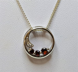 3 Garnet Circle And Cubic Zirconia Sterling Silver Pendant