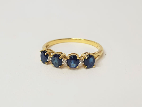 0.60ct Sapphire & 0.10ct Diamond 9ct Yellow Gold Ring