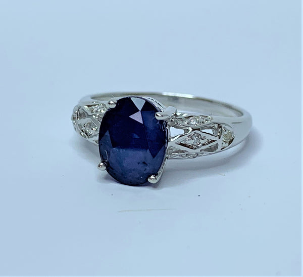 Oval Sapphire and CZ Decorated shoulders Sterling Silver Ring