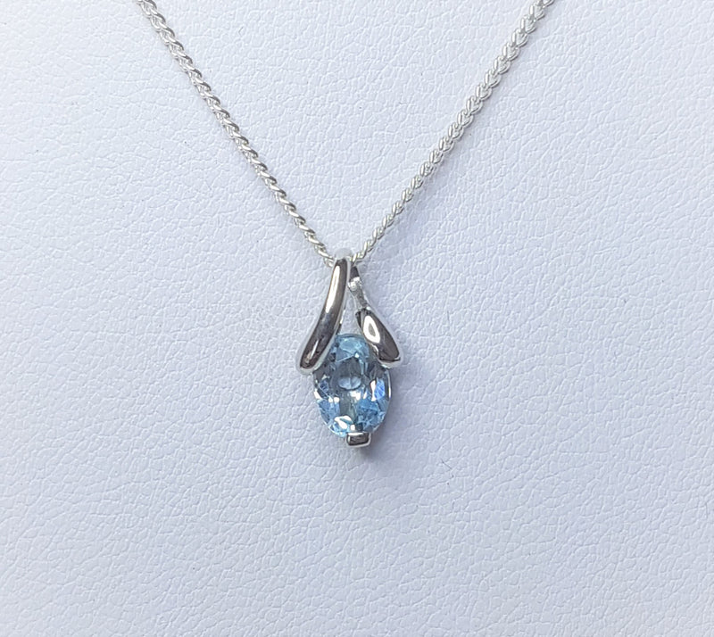 Oval Blue Topaz Twisted Bail Sterling Silver Pendant