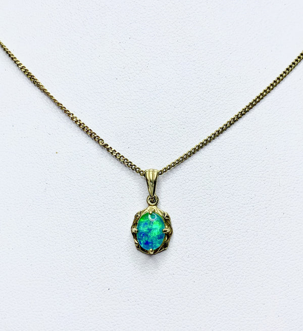 9ct Yellow Gold Oval Opal Pendant With Engraved Setting