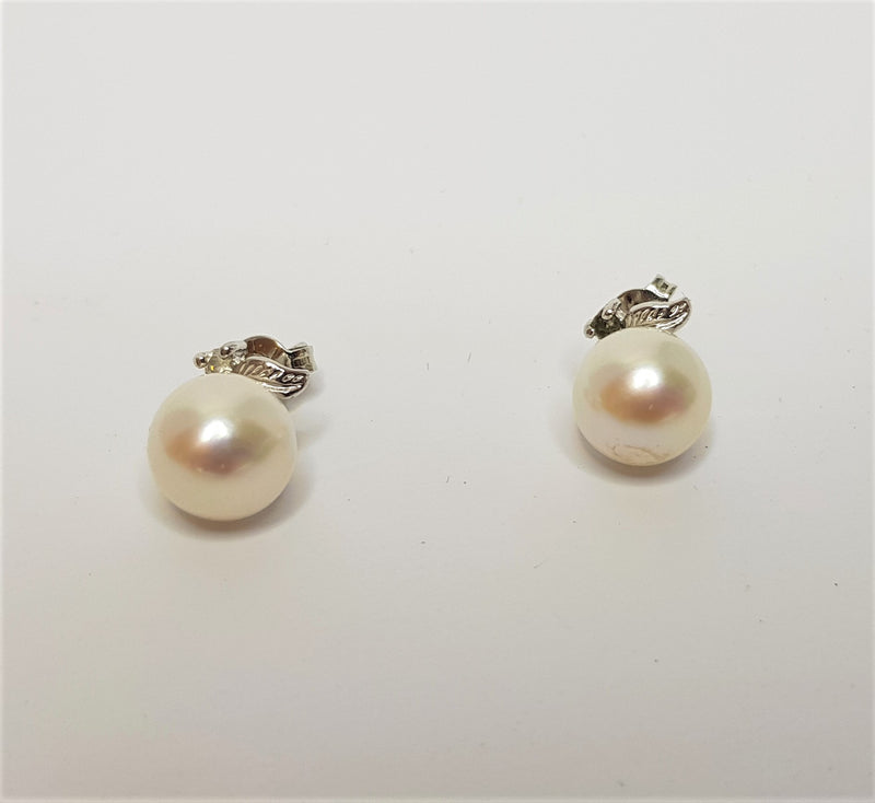 White Gold Plate Sterling Silver Pear Studs With Cubic Zirconia