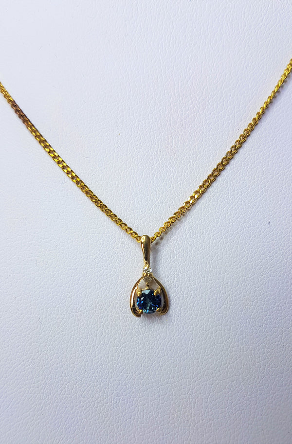 4mm Round Sapphire Set In a 9ct Yellow Gold Horseshoe Shaped Diamond Set Pendant