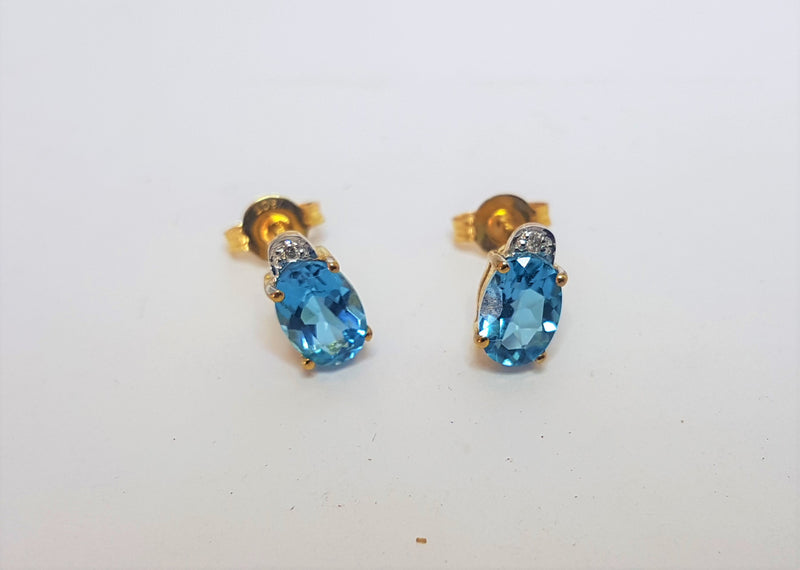 Oval Blue Topaz And Diamond 9ct Yellow Gold Studs