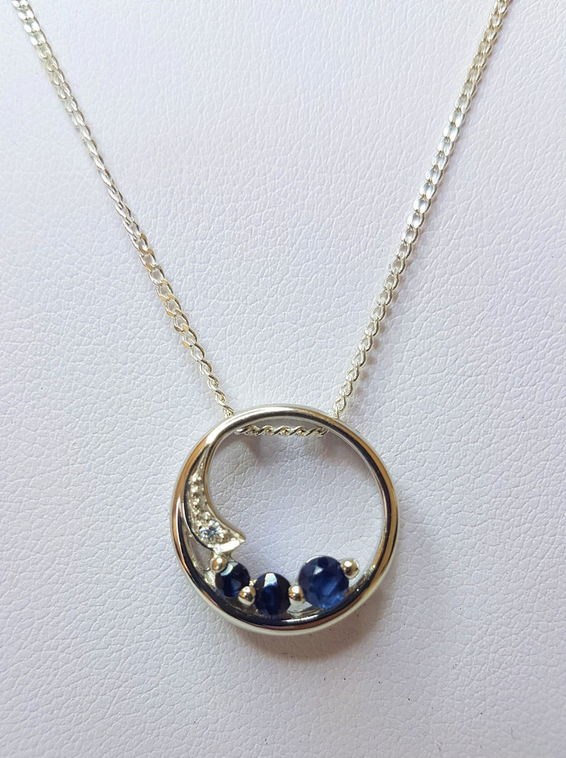 Three Sapphires Set in a Circle Sterling Silver Pendant With Cubic Zirconia