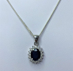 9x7mm Oval Sapphire and CZ Cluster Sterling Silver Pendant