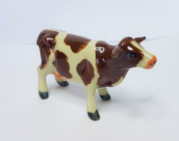 Cow Brown and White Ceramic Figurine - Small