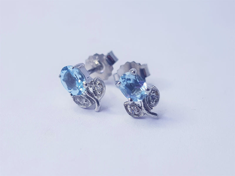 Blue Topaz and CZ Flower Sterling Silver Studs
