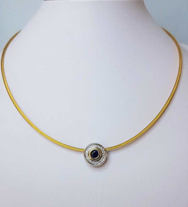 18ct Yellow Cable With 18ct Yellow And White Gold Circle Pavee Pendant Set With Diamonds .16ct Round Sapphire .52ct