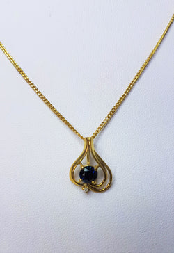Swirl With Diamond set Below a 5mm Round Stone 9ct YG Pendant