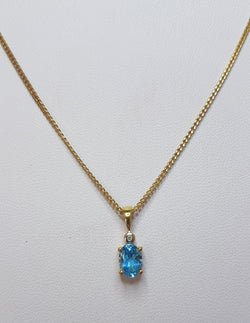 Oval Blue Topaz And Diamond 9ct Yellow Gold Pendant