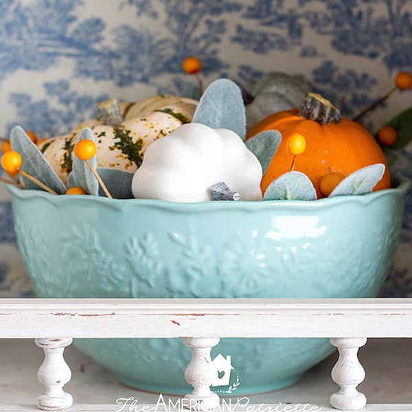 Mini pumpkins in aqua bowl