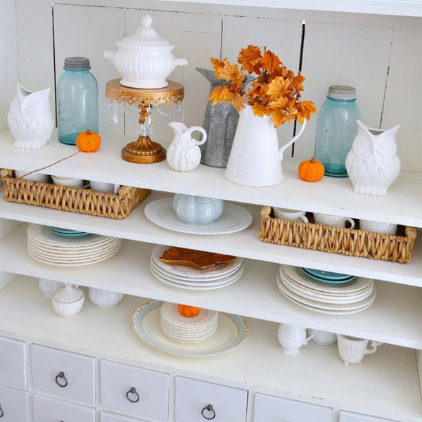 White cottage hutch decorated for fall