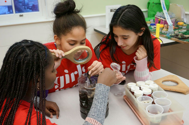3 young girls doing a science experiment at Girls Inc.