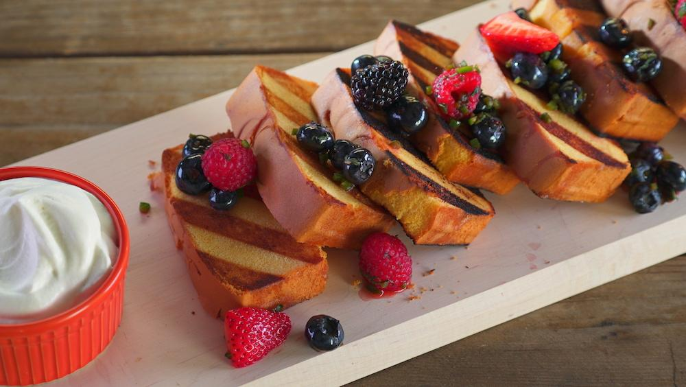 Slices of grilled poundcake with berry salsa