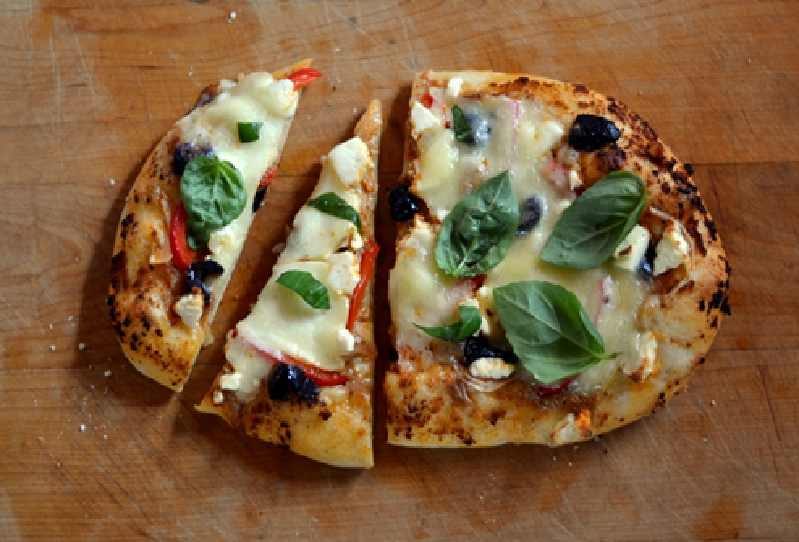 Pizza Grilled on Outdoor BBQ Grill