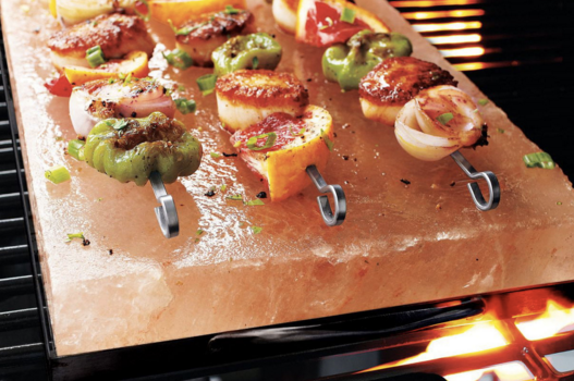 Best BBQ Accessories - Salt block on grill with veggie skewers