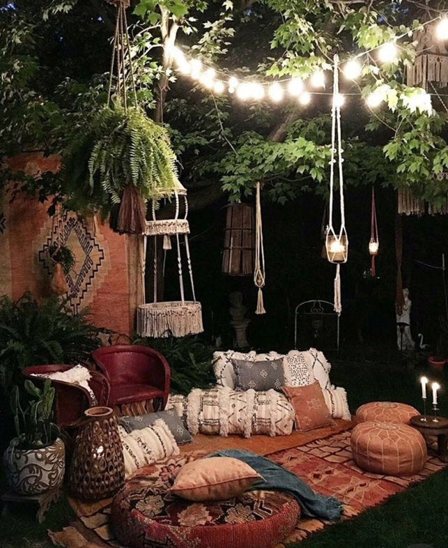 boho chic patio with floor cushions and lanterns