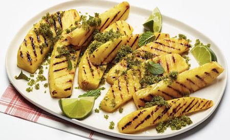 grilled pineapple with mint sugar, mint leaves, and lime slices