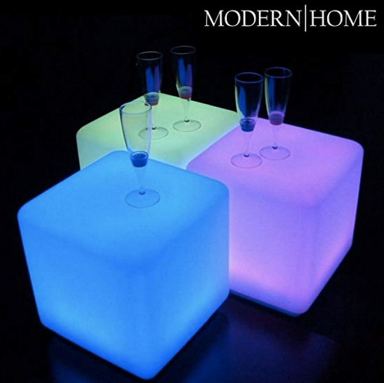 blue green and purple glowing LED cubes with wine glasses on top