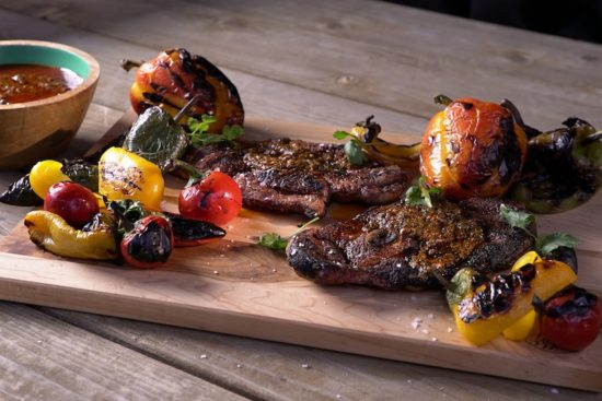 grilled lamb steaks with grilled peppers and herbs